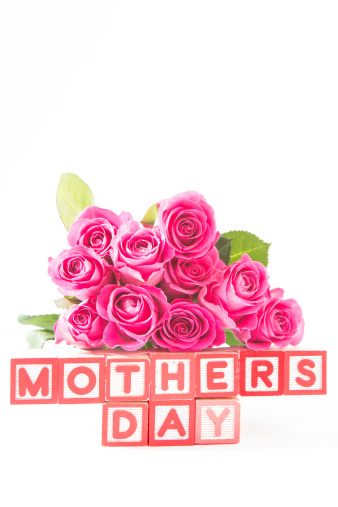 母の日「Bouquet of pink roses next to wooden blocks spelling mothers day」:スマホ壁紙(5)
