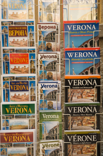Guidebook「Rack of different maps and guides to Verona」:スマホ壁紙(15)