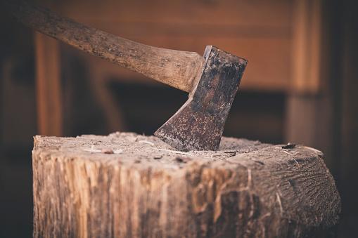 Durability「A weathered axe on a wooden chopping block.」:スマホ壁紙(12)