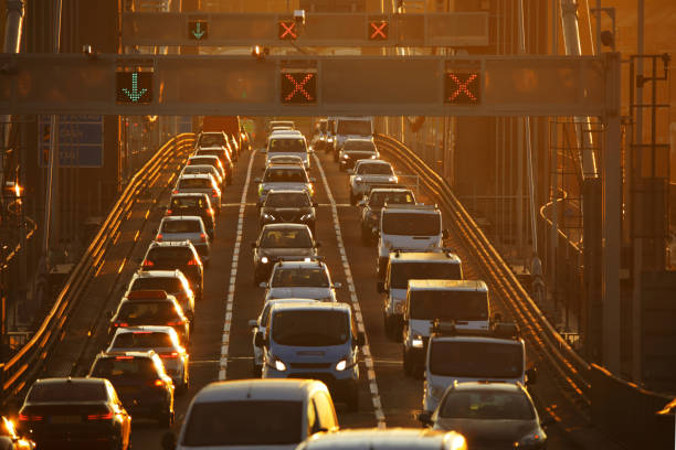 Heavy traffic on bridge at sunset:スマホ壁紙(壁紙.com)