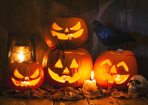 Halloween ghost「Halloween Jack-o-Lantern Pumpkins on rustic wooden background」:スマホ壁紙(17)
