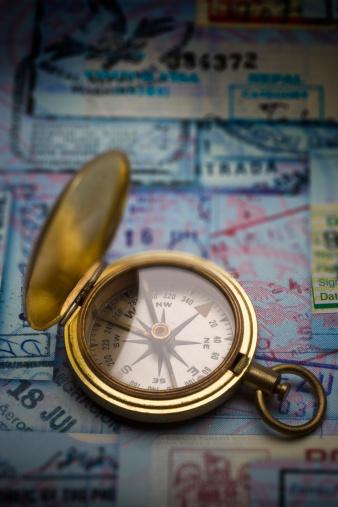 Passenger「Antique brass compass on collage of passport stamps」:スマホ壁紙(0)