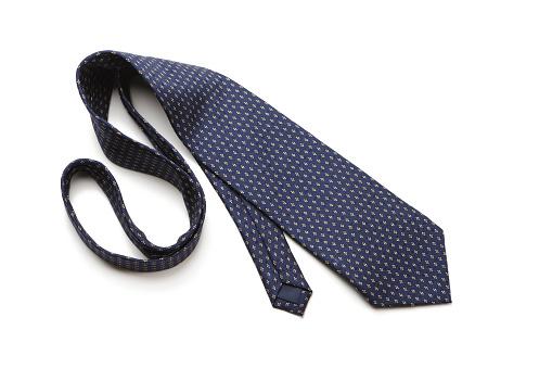 Necktie「Blue patterned necktie laying on white background」:スマホ壁紙(0)