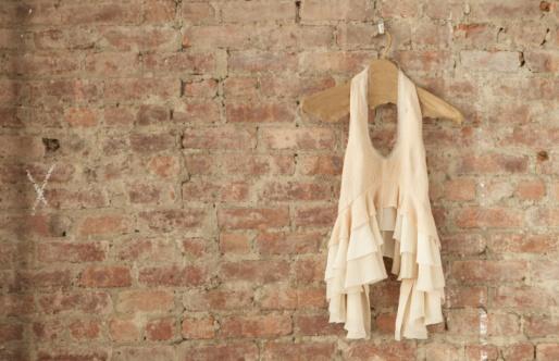 Halter Top「A shirt hanging on a brick wall」:スマホ壁紙(7)
