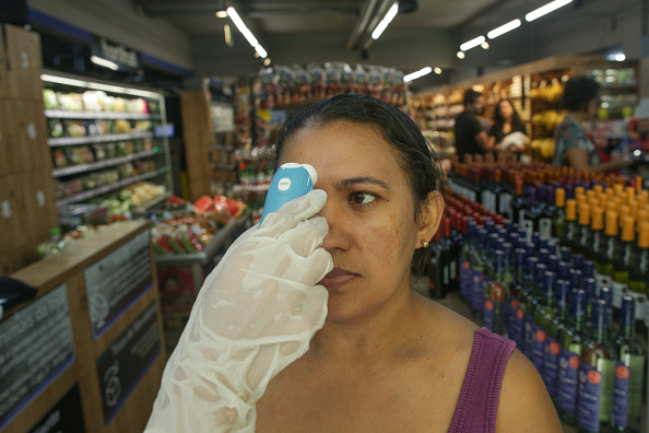 Thermometer「Local Supermarket Employees Check the Temperature of Clients as the Coronavirus (COVID-19) Continues to Spread」:写真・画像(6)[壁紙.com]