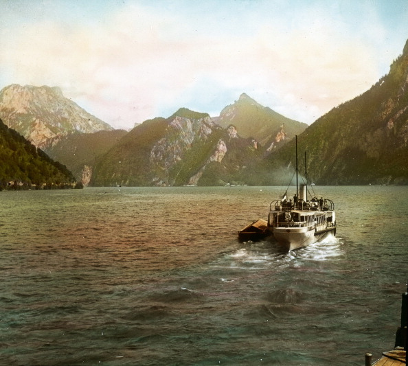 """Salzkammergut「The Paddle Wheel Steamer """"Gisela"""" On The Traunsee. Every Tuesday The Women Of Ebensee Went Shopping At The Farmer'S Market In Gmunden, Where They Had A Preemption. Salzkammergut. Upper Austria. Hand-Colored Lantern Slide. Around 1910.」:写真・画像(3)[壁紙.com]"""