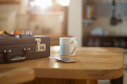 Briefcase「Suitcase and mobile phone on kitchen table.」:スマホ壁紙(18)