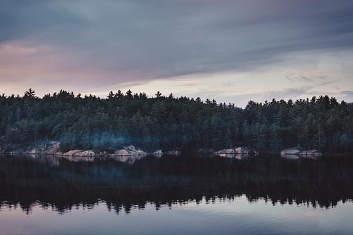 Lake Huron「Calm Lake At Dusk With A Canoe Crossing Over」:スマホ壁紙(15)
