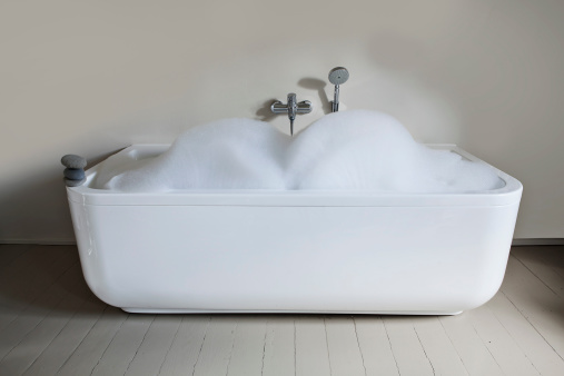Soap「Bathtub with soapsuds and pebbles in bathroom」:スマホ壁紙(2)