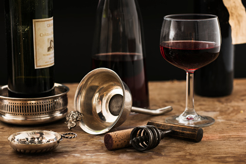 Wine Bottle「Still life with red wine glass, carafe and bottle on wooden table, studio shot」:スマホ壁紙(15)