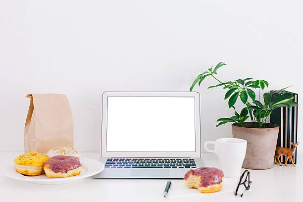Still life with laptop, donuts and plant on desk:スマホ壁紙(壁紙.com)