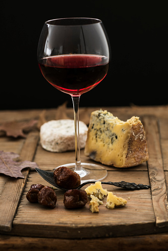 Cheese「Still life with cheese and red wine on wooden table, studio shot」:スマホ壁紙(0)