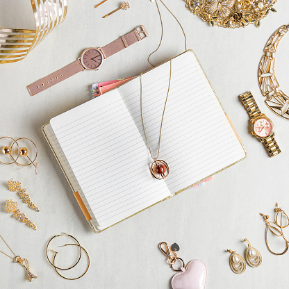 Earring「Open notebook with blank pages styled with different accessories like watches and necklace and other jewelries」:スマホ壁紙(8)
