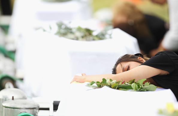 Mark Kolbe「Funerals Held For Victims Of Christmas Island Shipwreck」:写真・画像(14)[壁紙.com]