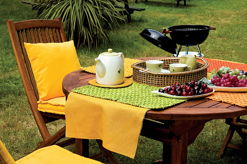Barbecue Grill「picnic table and barbecue on garden」:スマホ壁紙(12)