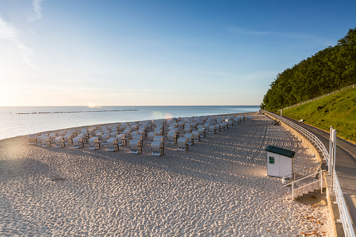 Baltic Sea「Germany, Ruegen, Sellin, view to beach with hooded beach chairs at morning twilight」:スマホ壁紙(6)