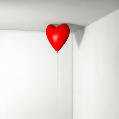 Corner「Red heart balloon floating in the corner of a room」:スマホ壁紙(10)