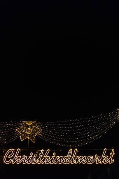 Germany, Munich, lighted sign of Christkindlmarkt:スマホ壁紙(壁紙.com)