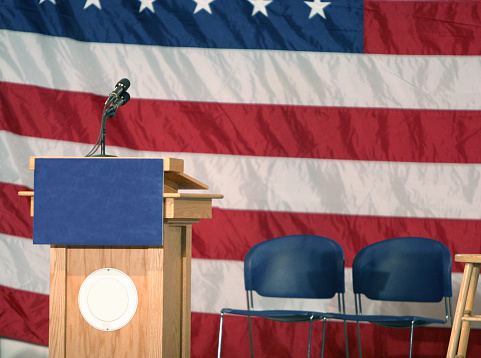 Election「Podium with USA flag backdrop and chairs by it」:スマホ壁紙(18)