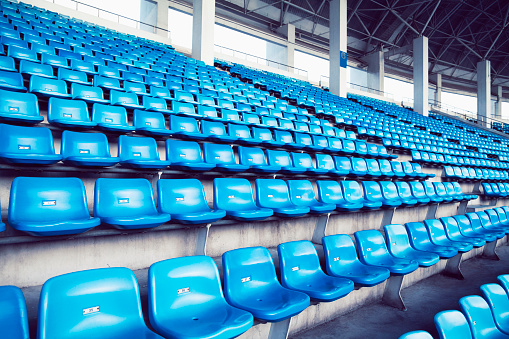 Competitive Sport「Empty blue arena seats with numbers in a stadium」:スマホ壁紙(17)