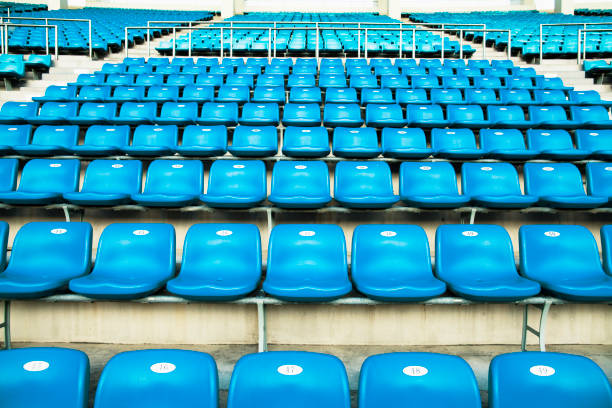 Empty blue arena seats with numbers in a stadium:スマホ壁紙(壁紙.com)