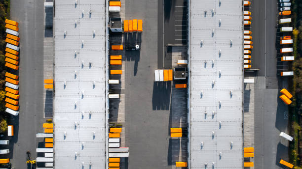 Distribution logistics building parking lot - aerial view:スマホ壁紙(壁紙.com)