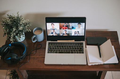 Working「an asian chinese mid adult man working from home with his new home office setup at living room」:スマホ壁紙(4)