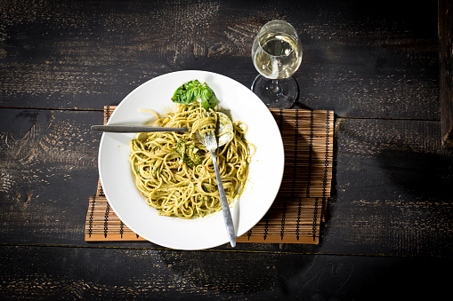 Pine Nut「Plate of spaghetti with pesto Genovese and glass of white wine」:スマホ壁紙(5)