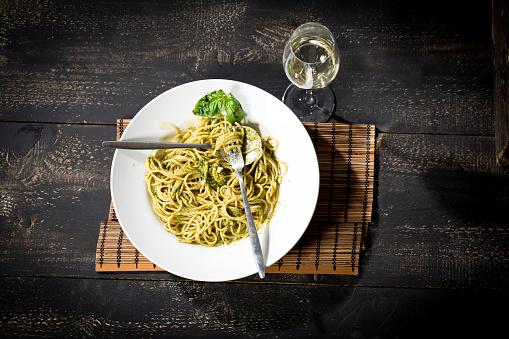 Pesto Sauce「Plate of spaghetti with pesto Genovese and glass of white wine」:スマホ壁紙(11)