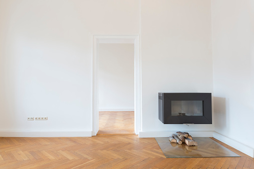 Parquet Floor「Spacious empty living room with herringbone parquet and fireplace」:スマホ壁紙(12)