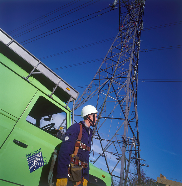Danger「Worker in safety harness ready to scale electricity pylon, United Kingdom.」:写真・画像(6)[壁紙.com]
