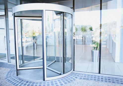 Business「Modern entrance with revolving door」:スマホ壁紙(14)