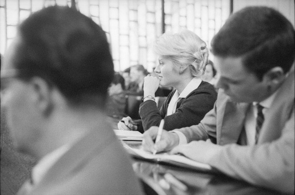 High School Student「Some Students Attending A Lecture At The University Of Cologne. Albertus-Magnus-Platz Place. Lindenthal. Cologne. Germany. 1955. Photograph By Franz Hubmann」:写真・画像(11)[壁紙.com]