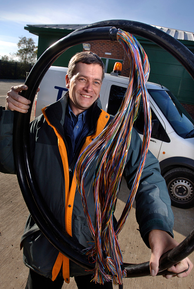 Mid Adult「A telecommunications network designer with telephone cables at an exchange, UK」:写真・画像(6)[壁紙.com]