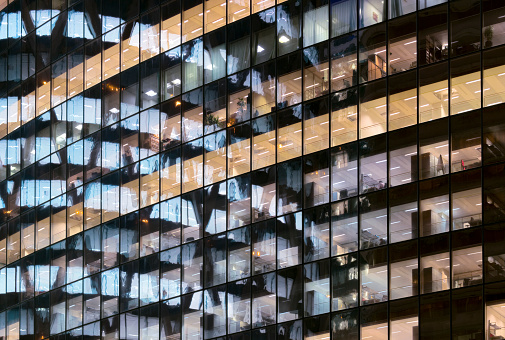 Skyscraper「Reflections in glass office facade at dusk」:スマホ壁紙(2)