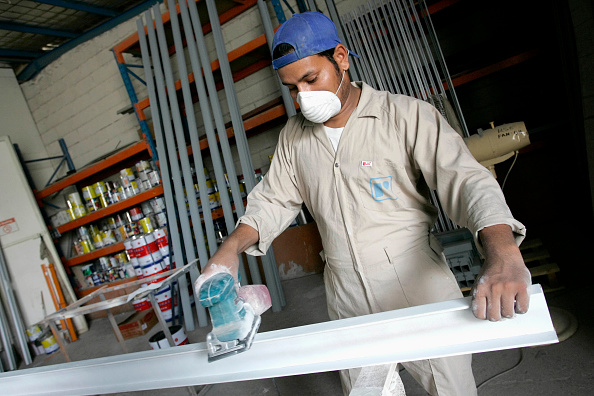 Carpentry「Employee sanding down parts for new cupboards」:写真・画像(13)[壁紙.com]