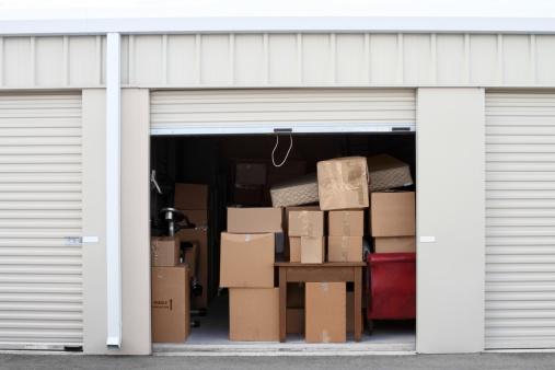 Storage Compartment「Self storage warehouse building with an open unit.」:スマホ壁紙(16)