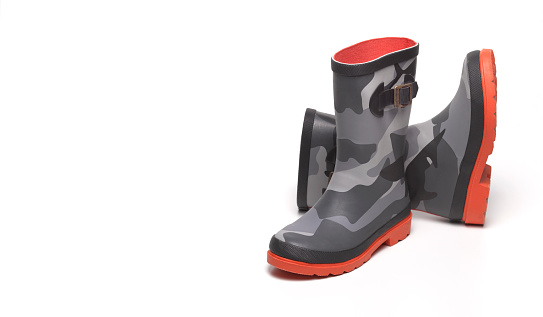 ミリタリー「Camouflage wellington boots with copy space」:スマホ壁紙(1)