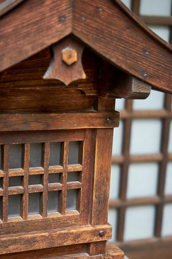 神社「detail of a wooden lantern in the shape of a building with roof in Nara Japan」:スマホ壁紙(16)