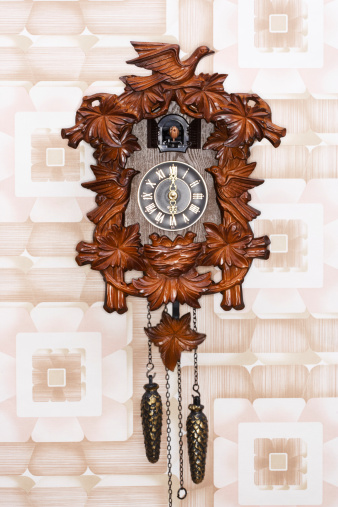 Roman Numeral「Cuckoo clock hanging on patterned wall」:スマホ壁紙(19)