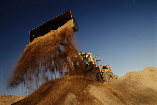 Construction Vehicle「Earth mover in quarry dumping sand, low angle view」:スマホ壁紙(19)