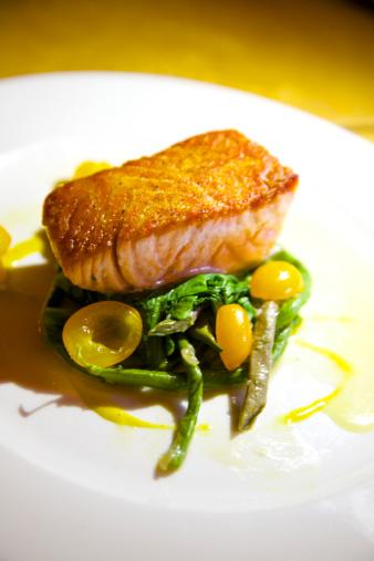 Vinaigrette Dressing「Fresh fish filet atop greens on white plate」:スマホ壁紙(11)