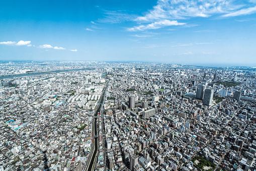 Urban Sprawl「Tokyo aerial panorama across skyscraper cityscape」:スマホ壁紙(9)