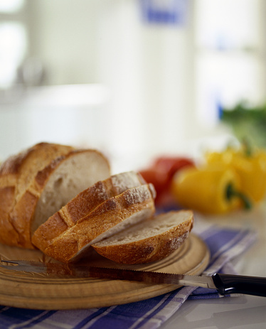 Carving Knife「Sliced bread on table with knife」:スマホ壁紙(5)