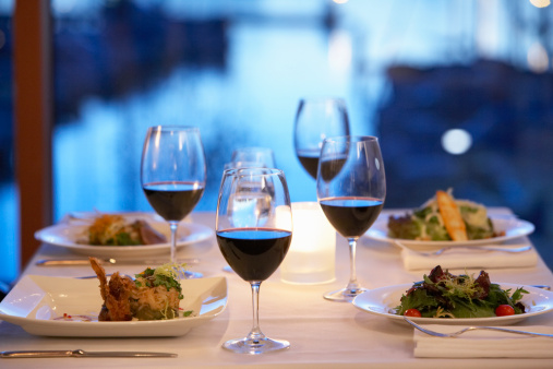 Meal「Red wine, appetizers and salads on table in restaurant」:スマホ壁紙(10)