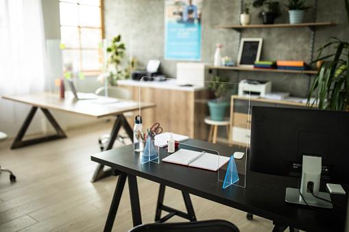 Banking「Desks with sneeze guard on it in bank office」:スマホ壁紙(9)