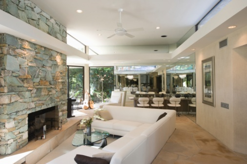 Ceiling Fan「Sunken seating area and exposed stone fireplace of Palm Springs home interior」:スマホ壁紙(10)