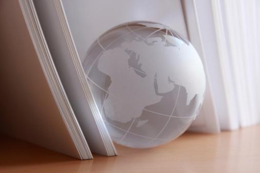 Trapped「glass globe among book sheets」:スマホ壁紙(16)