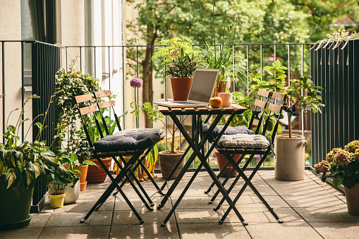 Outdoor Chair「Bistro chairs and table with laptop on balcony」:スマホ壁紙(18)