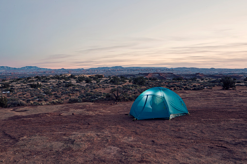 Tent「A tent glows at twilight deep in the Canyonlands National Park backcountry.」:スマホ壁紙(17)